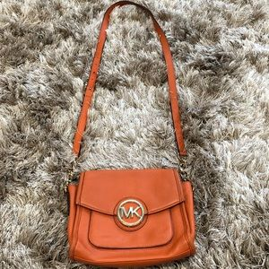 Michael Kors Crossbody tan purse.
